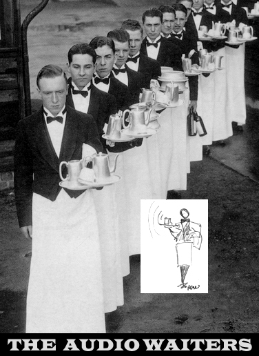 Antique black and white photo of waiters in formal attire